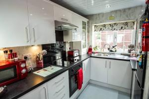 stunning kitchen with all mod cons, full size fridge/freezer .microwave, cooker and hob,. coffee machines, and assorted pods,and coffee, slow cooker,  sandwich toaster etc everything you need.